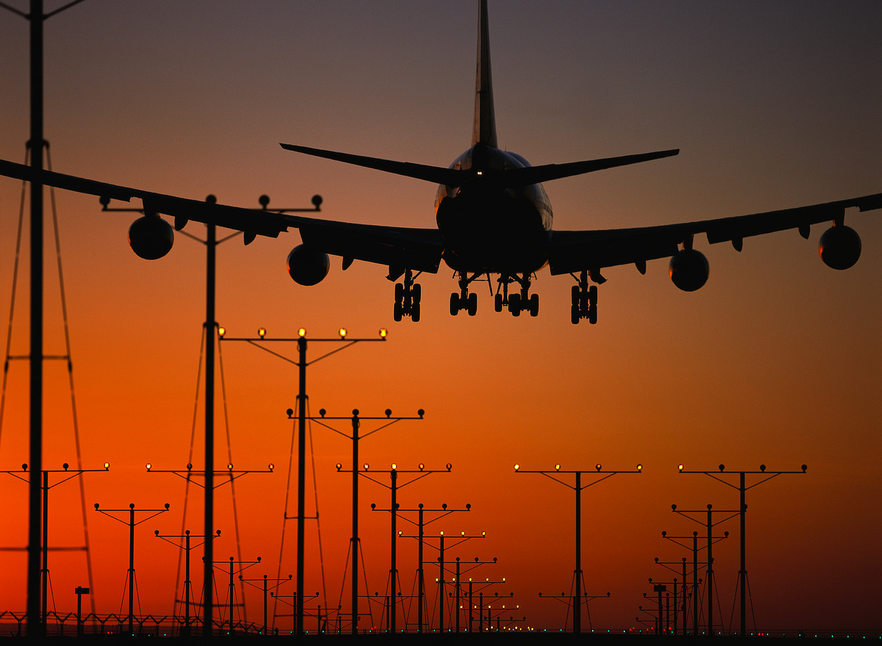 Jet Airplane Landing at Sunset